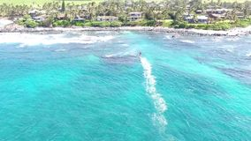 Top 4k aerial drone view of windsurfer gliding slowly in summer waves of turquoise blue ocean water in Hawaiian seascape stock video