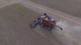 Top 4k aerial shot on big agriculture machine truck combine vehicle harvesting organic wheat crops from farming field. Top aerial shot on big agriculture machine stock footage