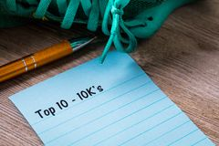 Top 10 - 10K`s run walk concept on notebook and wooden board. 10K run walk concept on notebook and wooden board Royalty Free Stock Image