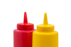 Top of a ketchup and mustard bottle closeup Stock Images