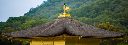 On top of Kinkakuji. A bird rests on top of Kinkakuji Temple in Kyoto, Japan Royalty Free Stock Photo
