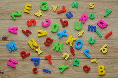 Top lay of scattered English letters on a wooden background Stock Images