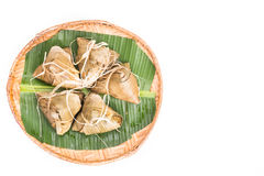 Top lay view on bunch of Chinese rice dumpling placed on traditional rattan tray Royalty Free Stock Photography
