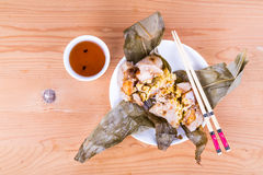 Top lay view of steamed Chinese rice dumpling or zongzi served with oriental tea Royalty Free Stock Image