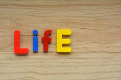 Top lay of the word Life on a wooden background Royalty Free Stock Photography