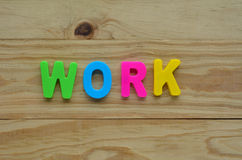Top lay of the word Work on a wooden background Stock Photo