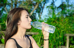 Top length asia young girl drink water Royalty Free Stock Photo