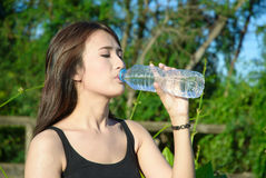 Top length asia young girl drink water Royalty Free Stock Photography