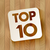 TOP10 lettering on wooden background Stock Photos