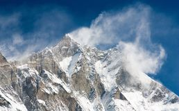 Top of Lhotse and Nuptse. With windstorm and snow clouds on the top Royalty Free Stock Photo