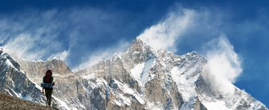 Top of Lhotse and Nuptse. With windstorm, turist and snow clouds on the top Stock Photos