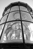 Top of lighthouse. Glass equipment of lighthouse consists of lenses, glow lamps and projector. The top of beacon is photographed upwards and closely Stock Photos