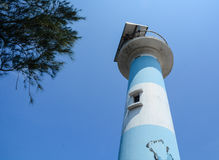 Top of lighthouse under blue sky. Top of Dinh Cau lighthouse in Phu Quoc Island, Vietnam. Phu Quoc is a Vietnamese island off the coast of Cambodia in the Gulf Stock Image