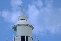 TOP OF LIGHTHOUSE WITH WEATHER VANE Royalty Free Stock Photography