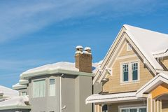 Top of luxury residential houses in snow on winter sunny day in Canada royalty free stock photography
