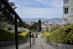The top of the Lyon Street Steps looking towards San Francisco Bay and Marin beyond, 2. Many of San Francisco`s steps have very beautiful mosaics added to the stock images