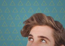 Top of man`s head against blue background with yellow triangle pattern Stock Photography