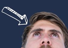Top of man's head looking up with white downward arrow against navy background Stock Photography