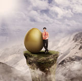 Top manager has idea. Top management has big golden egg (idea) outdoor Stock Photography