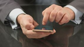 Top manager, boss typing text on smartphone, sending message. Stock footage stock video footage