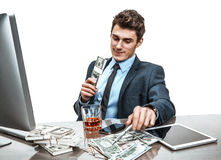 Top manager celebrating with a glass of whiskey, relaxing in break time Royalty Free Stock Photo