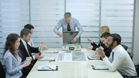 Top managers celebrate success. Boss distributes fee subordinates stock footage
