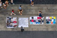 Top manta mantero bootleg peddler. Illegal sellers in the streets of Madrid with blankets plenty of merchandise. Top manta, mantero. bootleg peddler royalty free stock images