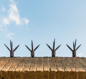 Top masonry wall with sharp spikes Stock Photos