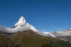 Top of Matterhorn with snow with deep blue sky. And green meadow Royalty Free Stock Photos