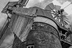 Top of the Mill. A monochrome view of the cap of the 18th century Stansted Mountfitchet windmill, showing the cap and fan mechanism Royalty Free Stock Photo