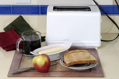 Top of The Morning. Breakfast of toast, coffee, and an apple is readied Stock Photos