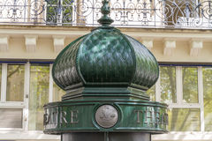 Top of morris column in Paris, France Royalty Free Stock Photography