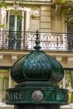 Top of morris column in Paris, France Royalty Free Stock Images