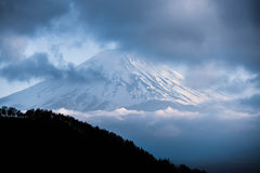 Top of mount Fuji in the clouds Stock Photo