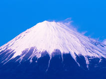 The top of Mount Fuji covered in snow stock photography