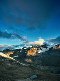 Top of the mount. Snow capped mountains. Summits of the mountains. View of the Alpine mountains at the sunrise. Trek near Matterhorn mount Stock Photography