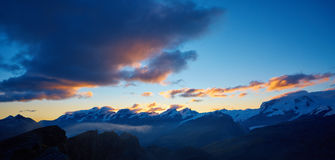 Top of the mount. Snow capped mountains. Summits of the mountains. View of the Matterhorn region mountains at the sunrise. Trek near Matterhorn mount Royalty Free Stock Photography