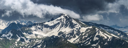 Top of mount Zakzan-Syrt covered by snow. Stock Photos