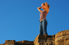 Top of mountain. Young woman tourist at the top of mountain Royalty Free Stock Photos