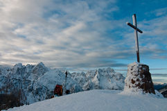 Top of the mountain. Peak of the mountain with cross royalty free stock photo