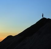 Top of a mountain. A person take his new challenge at the top of a mountain Royalty Free Stock Image