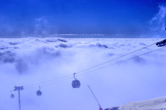 On top of the mountain above the clouds Stock Images
