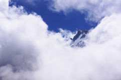 The top of the mountain in the clouds. The mountain in the clouds sunny day Royalty Free Stock Photo