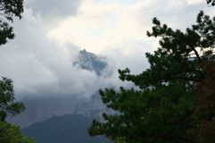 Mountain in dense fog and clouds Stock Photo