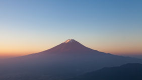 Top of mountain Fuji and sunrise sky Royalty Free Stock Image