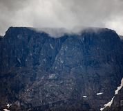 Top mountain Khibiny in the form of a background of the cloud. Y sky Stock Photo