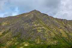 Top mountain Khibiny in the form of a background of the cloudy. Sky Stock Photography