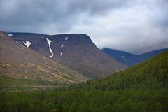 Top mountain Khibiny in the form of a background of the cloudy. Sky Stock Image
