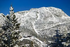 Top of the mountain, Mt. Mansfield, Stowe, Vermont, USA. Mt. Mansfield looming over the top of the 8 person gondola ski lift in winter, Stowe, Vt, USA stock image