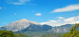 The top of the mountain Olympos Turkey against the blue sky. Wide photo Royalty Free Stock Photography